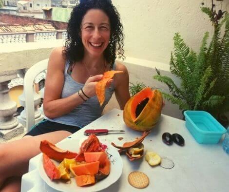 Rachel eating a papaya in Cuba on our Cuba cycling tour