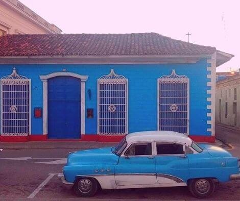 Blue house and blue bike on our cycling tour in Cuba