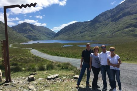 4 people in front of Wild Atlantic Way discovery point on a private tour