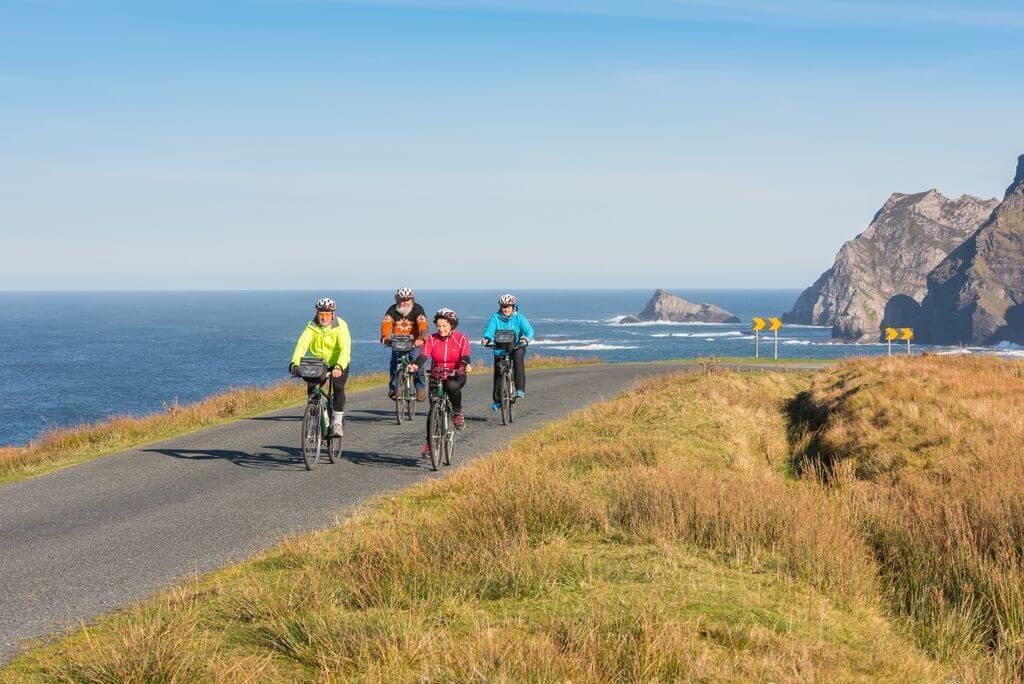 A group cycling along the Wild Atlantic Way Ireland