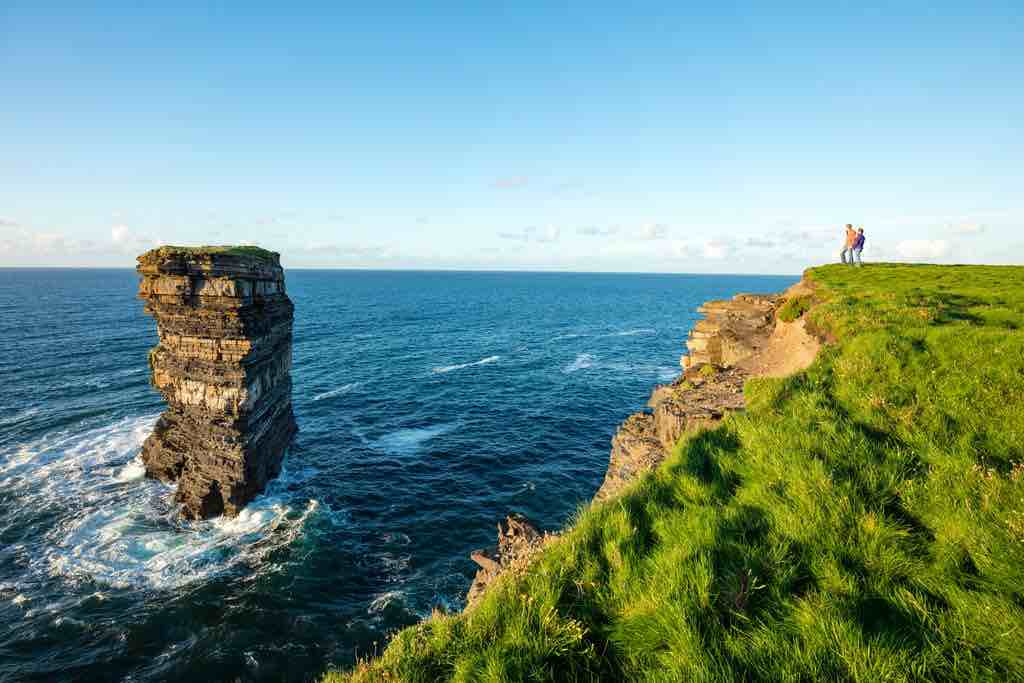 Ireland bucket list must do: Follow the cliff around Downpatrick Head and be impressed by Sea stack Dun briste