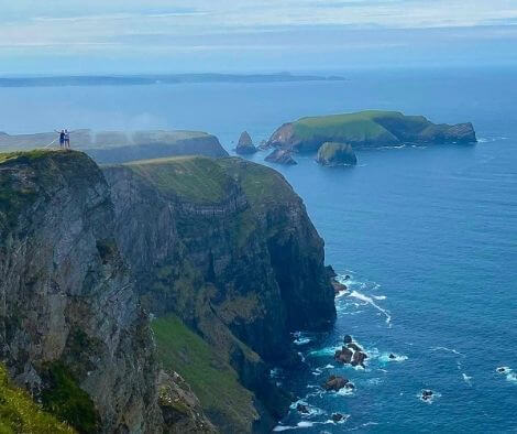 2 people standing on the cliffs of Carrowteige in Ireland - top 10 trail routes hiking and trail running in Ireland