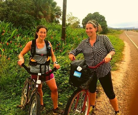 Rachel & Iszy with single speed bikes on the side of a road in Belize