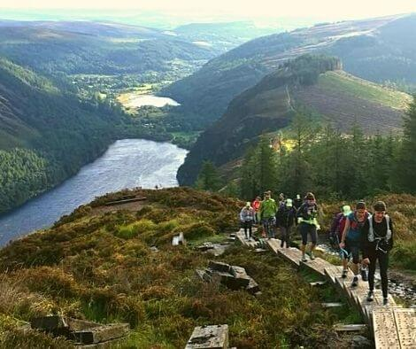 A group hiking up Glendalough - top 10 trail routes hiking and trail running in Ireland