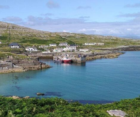 View over Inishturk harbour - top 10 trail routes hiking and trail running in Ireland