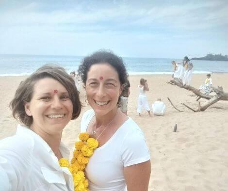 Rachel and Iszy on a beach in Goa after their Yoga Teacher Training graduation